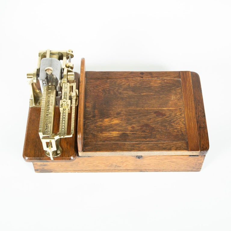 An Edwardian brass and oak weighting scales by W & T Avery of Birmingham.  Imperial measurements of Stones, Pounds and ounces.  Marked: AVERY LD BIRMINGHAM REGD NO 209249  W & T Avery Ltd. is a British manufacturer of weighing machines. The