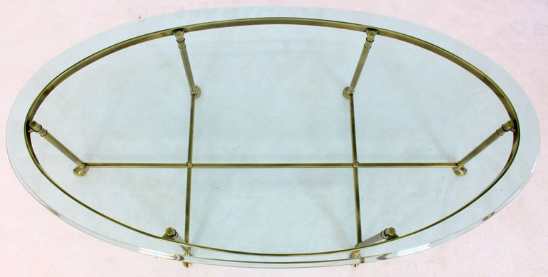 Mid-Century Modern solid brass oval coffee table. Measures: 3/4