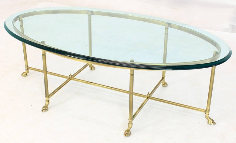 Mid-Century Modern Brass Oval Hoof Feet Coffee Table Thick Bevelled Glass For Sale