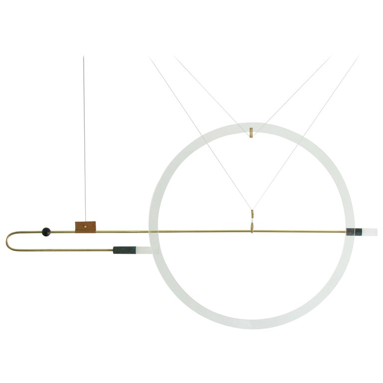 Sculpted light suspension - Portraits -Opus X – Periclis Frementitis.  Materials: solid brass (aged & polished) curved with fire on hand, bronze parts, handcrafted glass, handcrafted leather, acrylic parts, 12V LED  Dimensions: W 125 cm x H 65
