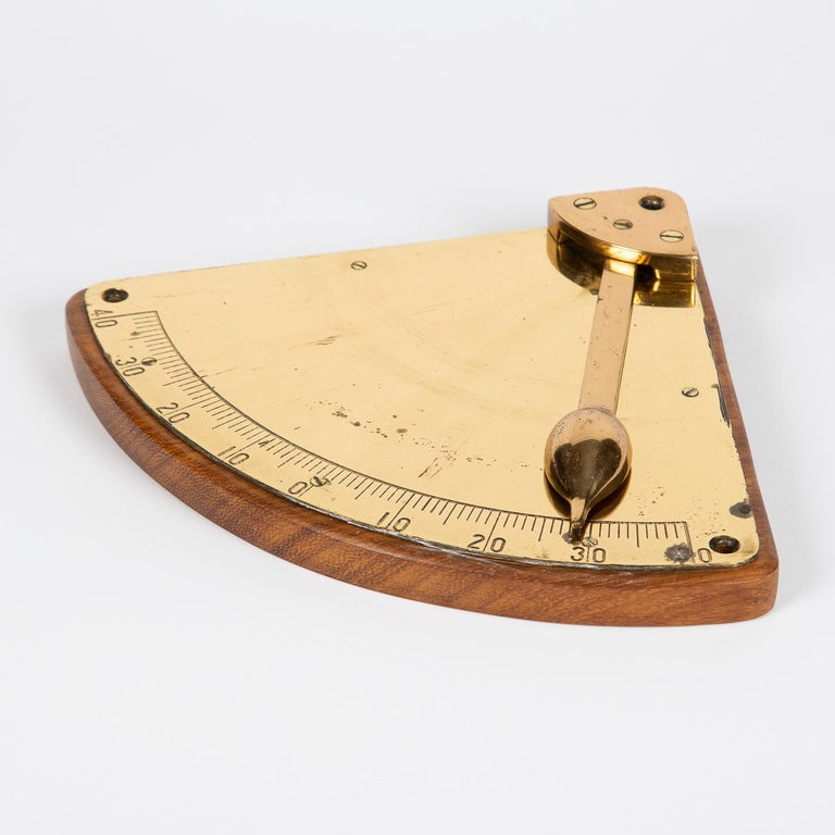 A brass ship's inclinometer, circa 1910.