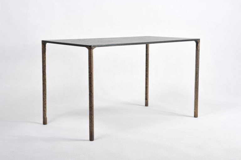 Brass side table signed by Lukasz Friedrich Textured side or coffee table Materials: Legs, patinated brass; top, patinated and waxed steel Dimensions: D 38 cm, L 68 cm, H 40 cm Signed and dated  Lukasz Friedrich (born 1980), lives and works in