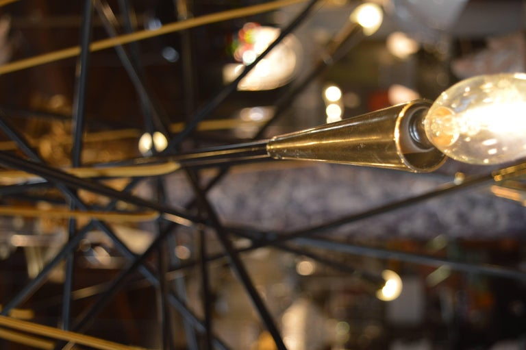 Sputnik chandelier, with brass details and silk gold chord. The height can be adjusted.