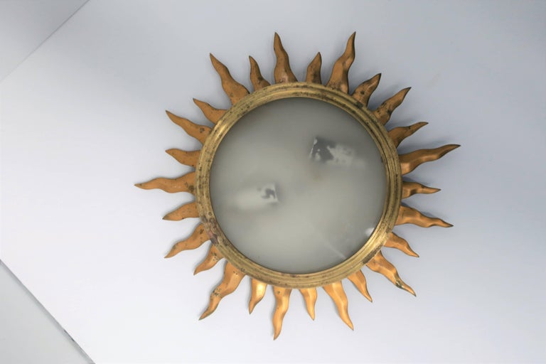 Vintage brass and translucent glass starburst flush mount (flushmount) ceiling light.  There are two available. Lights are being sold individually.  Measurements: 2 in. height x 15 in. diameter Light/lamp area only: 8.25 in. diameter  Second light