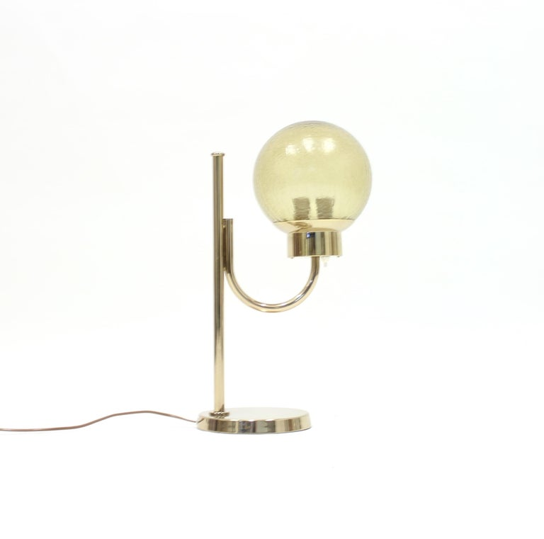 Brass table lamp with glass globe shade by Bergboms, model B-090. This model holds two light sources of maximum of 25w each. Very good vintage condition with very light ware.