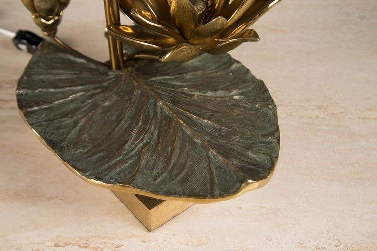 """Patinated brass featuring a waterlily leaf and blossom, supporting a rectangular metal shade. Signed """"Charles"""" underneath the leaf. Model Nilufar."""