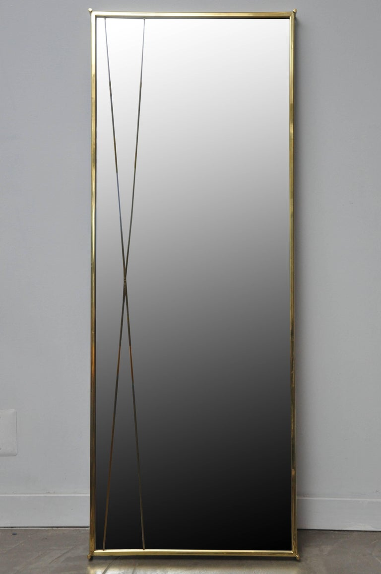 Brass 'X' mirror by Paul McCobb for Bryce Originals. Designed in 1956 to compliment the Calvin Group of furniture. Brass frame and glass mirror are in excellent original vintage condition.