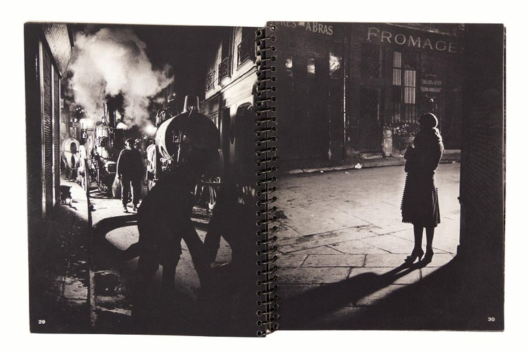 BRASSAI.  Paris de Nuit.  With text by Paul Morand.  Illustrated with 62 photographs by Brassai and photographic endleaves.  8vo., bound in original wrappers picturing a Brassai photograph, title printed in red, spiral bound, in a black cloth