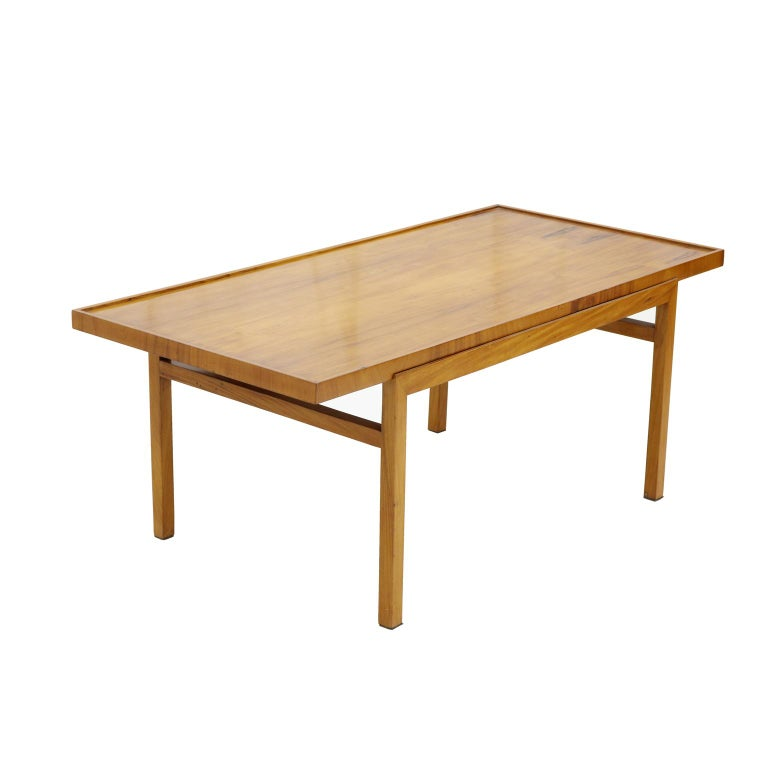 Brazilian midcentury coffee table in caviúna wood by Peter Kraft, 1950s.  Peter Kraft opened his own store in Sao Paulo in the 1950s. He designed clear shapes and usually worked with Caviuna wood with great attention to detail.