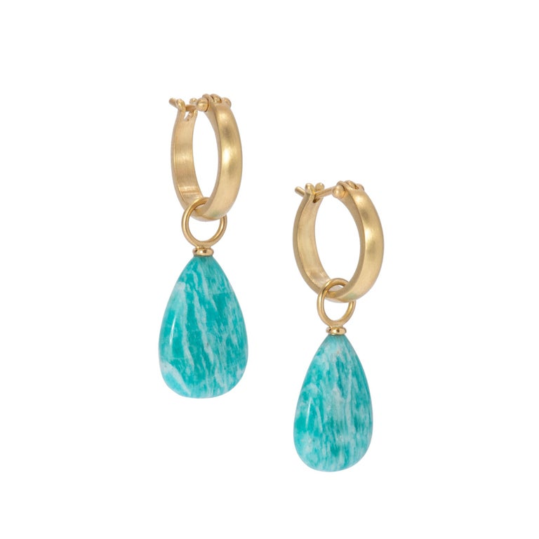Brazilian Amazonite Drop Earrings in 18k gold are a deep turquoise blue with natural streaks in white, 18.89 ctw. Hand crafted in our studio, Brazilian ammonite drop earrings are fitted with 18k gold caps and bails and hang from our large plain