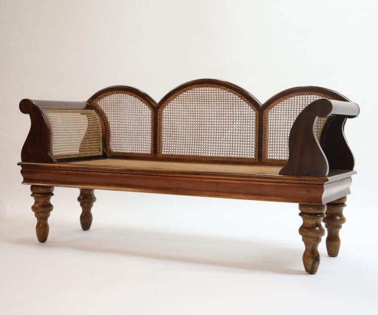 Gorgeous Art Deco 1930s Brazilian Jacaranda rosewood sofa with scrolled arms and beautiful caning, just shipped recently by our team from Rio De Janeiro where this was sourced.   This romantic sofa is large enough to sit three but can also be used