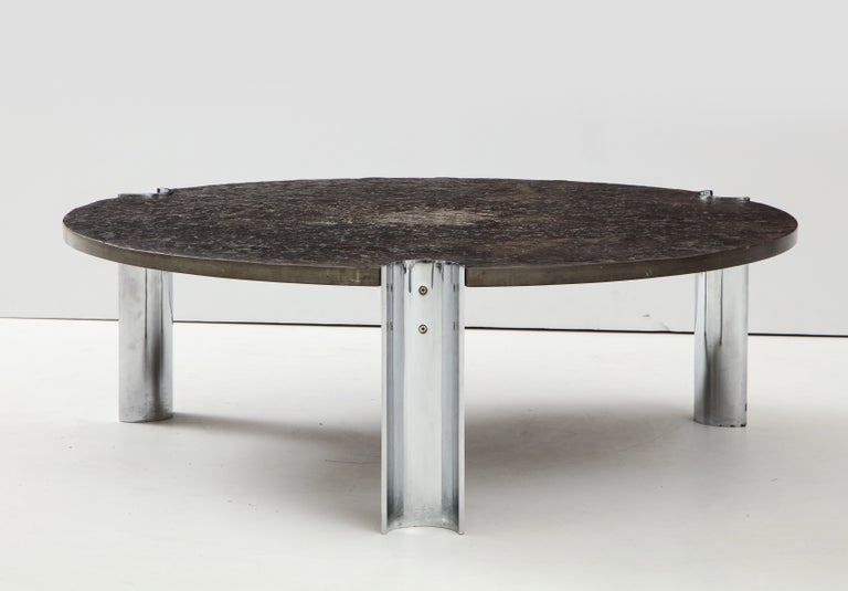 Brazilian Limestone and chrome coffee table. The rough, organic texture of the limestone slab gives the strong, industrial design an extra dimension.