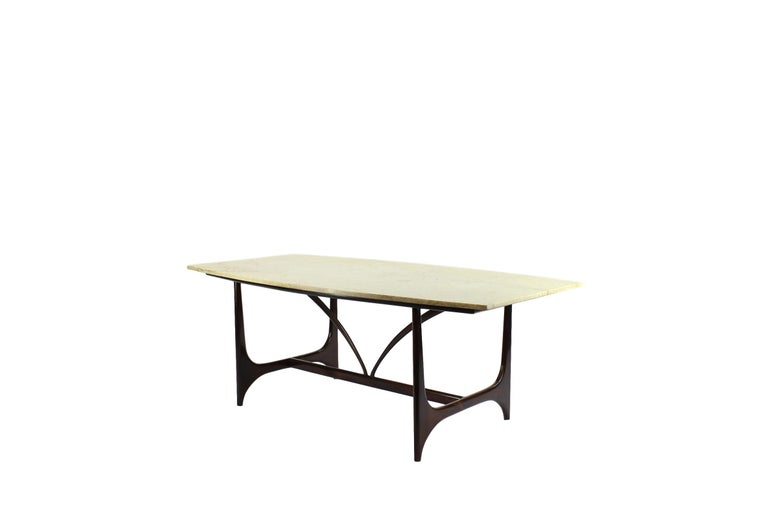 """Spectacular dining table in rosewood and marble on top designed as a tribute of Brasilia shapes.  Referred to often as the """"father"""" of Brazilian modernism, furniture designer Joaquim Tenreiro, who was born in Portugal and moved to Rio de Janeiro in"""