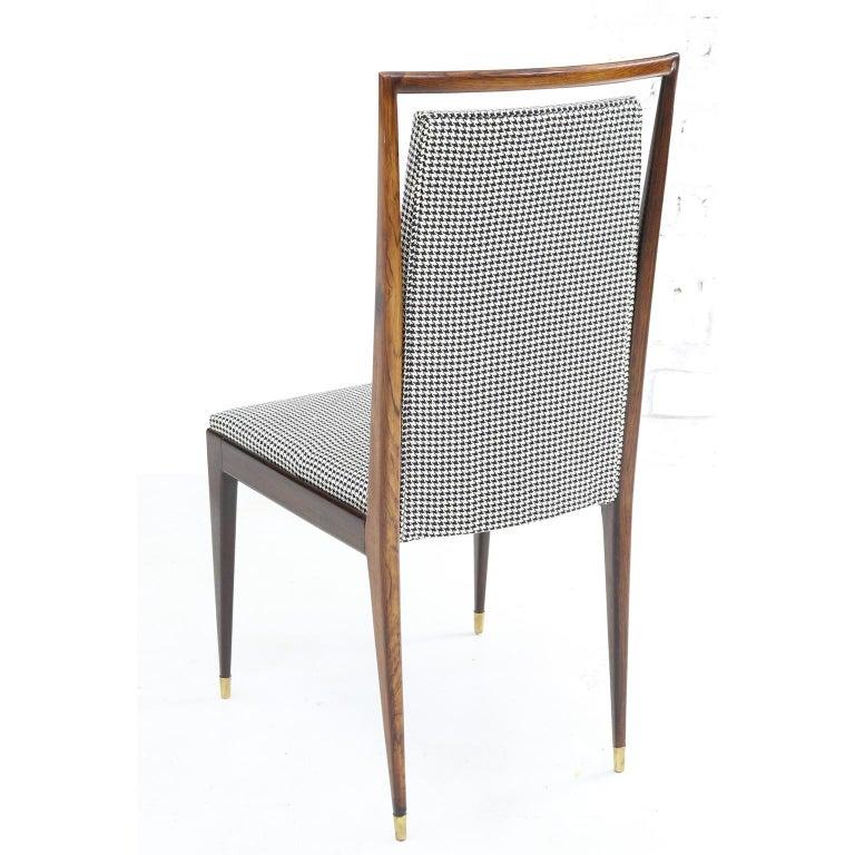 Manufacturer Móveis Teperman chair in jacaranda and brass sabots, Brazil, 1950s set of eight.