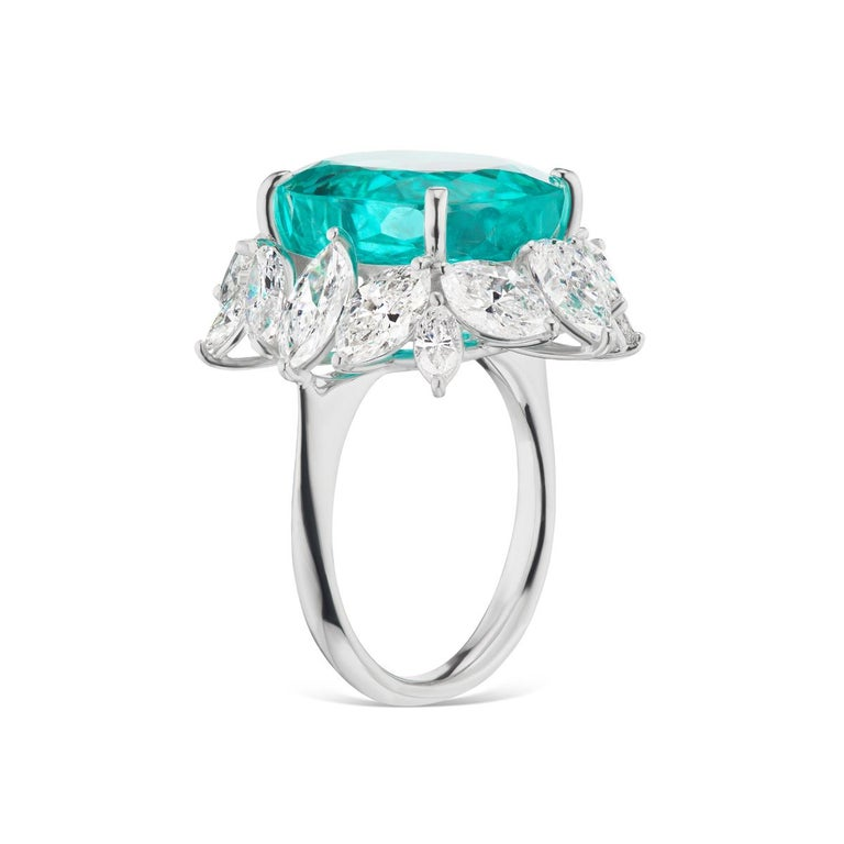 RARE & UNIQUE NEON BLUE BRAZILIAN PARIBA AND DIAMOND RING BY TAKAT A gorgeous Neon Blue Un treated Brazilian Paraiba Tourmaline gets the sweetheart treatment with a simple diamond setting. Brazilian Pariba is certified by AGL and Gubelin Lab.
