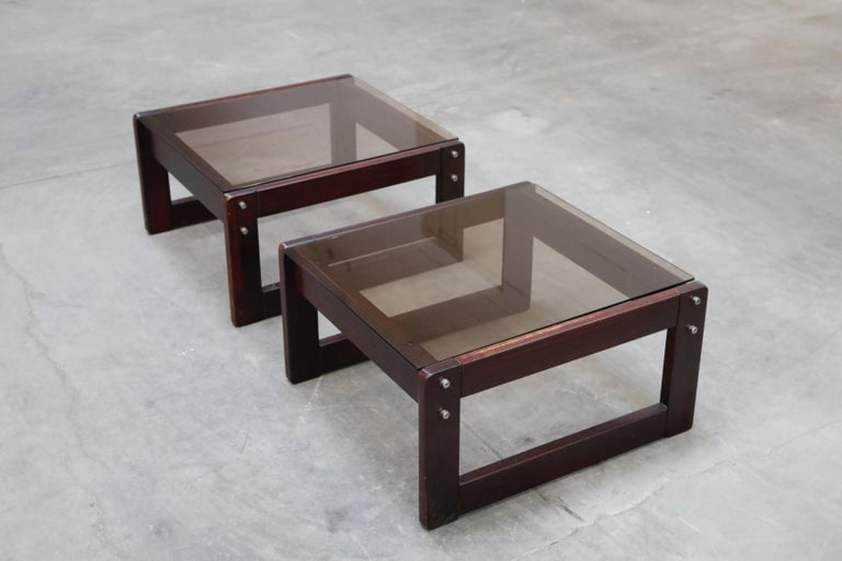 A fantastic pair of beautiful Brazilian rosewood and smoked glass side tables by coveted designer Percival Lafer. These 1960s end tables were made in Brazil and are a favorite amongst collectors, designers, artists and galleries. As rosewood is now