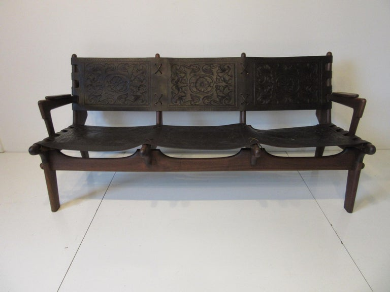 A handcrafted three-seat sofa by famed designer and craftsman Ecuadoran Angel Pazmino made during the height of the 1960s Mid-Century Modern movement in South America. Made of solid rosewood using pegs and fitting together like a interlocking
