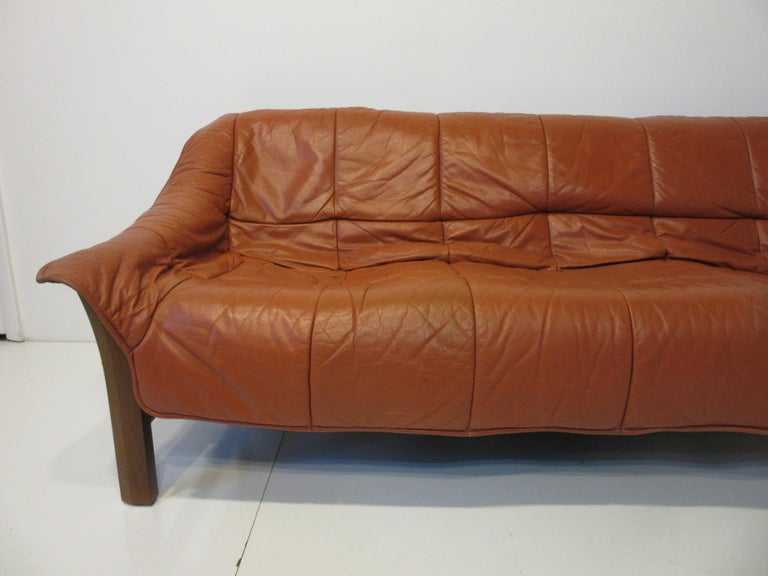 A leather sofa with a solid Jacaranda rosewood frame, this super comfortable piece is perfect for the living space that needs a rich but relaxed look. Well-made and with heavy leather which is great for long term wear manufactured in Brazil.