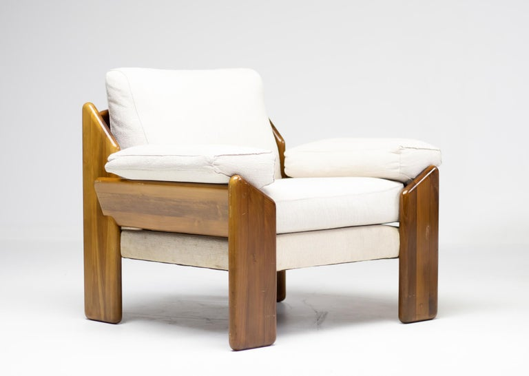 Distinguished Mid-Century Modern lounge chair and 3-seat in solid Brazilian rosewood. The original upholstery is not damaged or stained but shows its age, especially on the frame under the seats. The rosewood base is in nice vintage condition, and