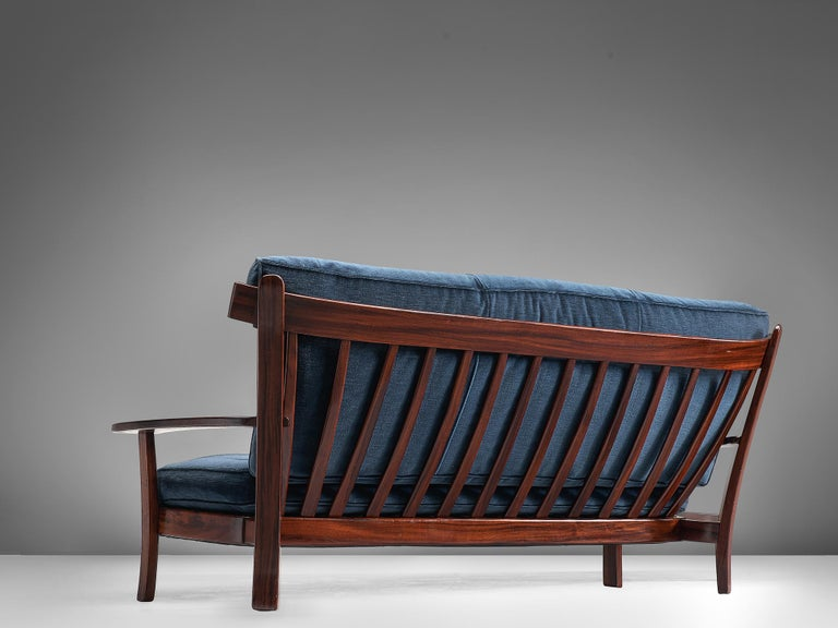 Sofa, rosewood, velvet, Brazilian design, European execution, 1960s.  This settee is executed in Brazilian rosewood and velvet and holds several well-constructed details such as the slatted back and the use of slender and delicate slats of