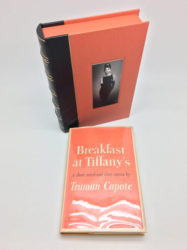 """""""Don't forget. Please feed the cat"""", - Breakfast as Tiffany's   First edition, first impression with first dust wrapper of Truman Capote's Classic novel chronicling the adventures of free-spirited Holly Golightly. Housed in a custom leather and"""