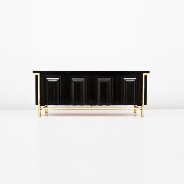 This stunning and distinct black lacquered and brass detail credenza or sideboard by Mastercraft. Meticulous attention to detail and superb construction, with graphic geometric door design and architecturally inspired platform base. Top features