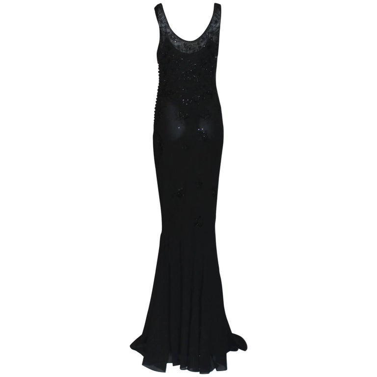 An extremely luxurious and CHRISTIAN DIOR signature piece that will last you for years Gorgeous, couture-like piece hand-crafted by the seamstresses in Christian Dior's atelier in Paris, FRANCE A stunning evening gown by Christian Dior Embroidered