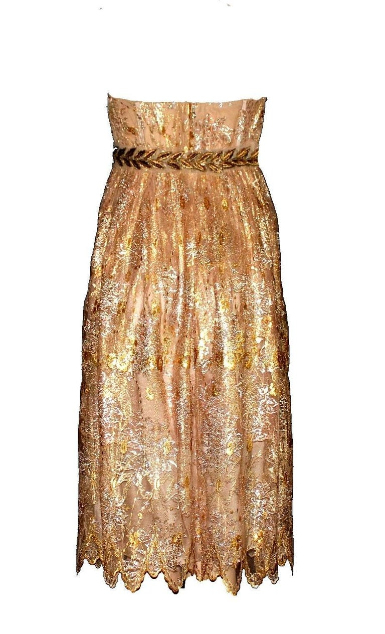 GORGEOUS DOLCE & GABBANA GOLDEN LACE DRESS  ONE OF THE MOST BEAUTIFUL PIECES BY  DOLCE & GABBANA  DETAILS:      A DOLCE & GABBANA timeless classic signature piece that will last you for years     Main line DOLCE & GABBANA     Made out of the finest