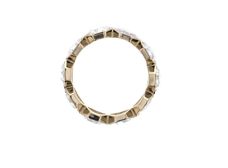 One of our all time favorite pieces! This is a stunning rose cut diamond eternity band made in 18k yellow gold and has 10 hexagon cut diamonds in a connected setting. Each diamond has 8 prongs keeping it securely in place. We love rose cut diamonds