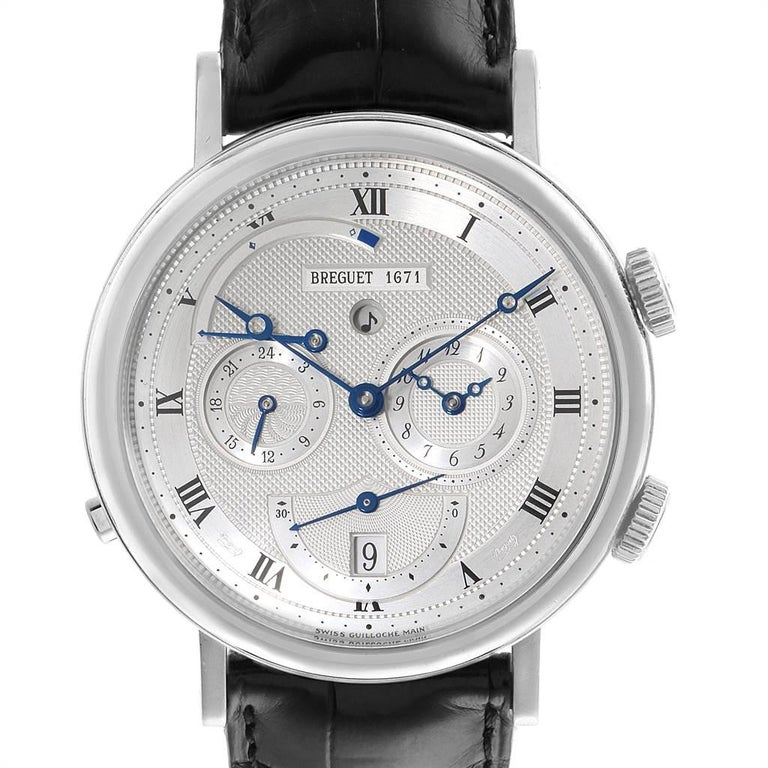 Breguet Classique Alarm Le Reveil du Tsar 18K White Gold Watch 5707. Automatic self-winding movement. 45-hour power reserve. 18K white gold case 39.0 mm in diameter. Transparent case back. Crown at 2 to wind movement and alarm and set 2nd time.