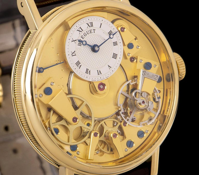 Breguet Tradition Yellow Gold Champagne Open Worked Dial 7037BA/11/9V6 Watch In Excellent Condition For Sale In London, GB
