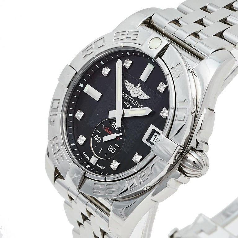 The classy elegance of this watch from the house of Breitling is showcased in its construction. Part of the Galactic collection, the watch is beautifully crafted from stainless steel. It features a black-colored dial with diamond hour markers, a