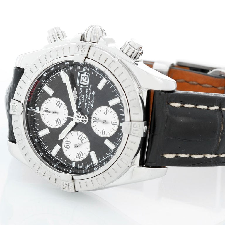 Breitling Chronomat Evolution Men's Watch A1335611 - Automatic winding chronograph. Stainless steel case with steel bezel (42 mm). Black dial with polished hour markers. Black alligator with Breitling deployant clasp. Pre-owned with Breitling box