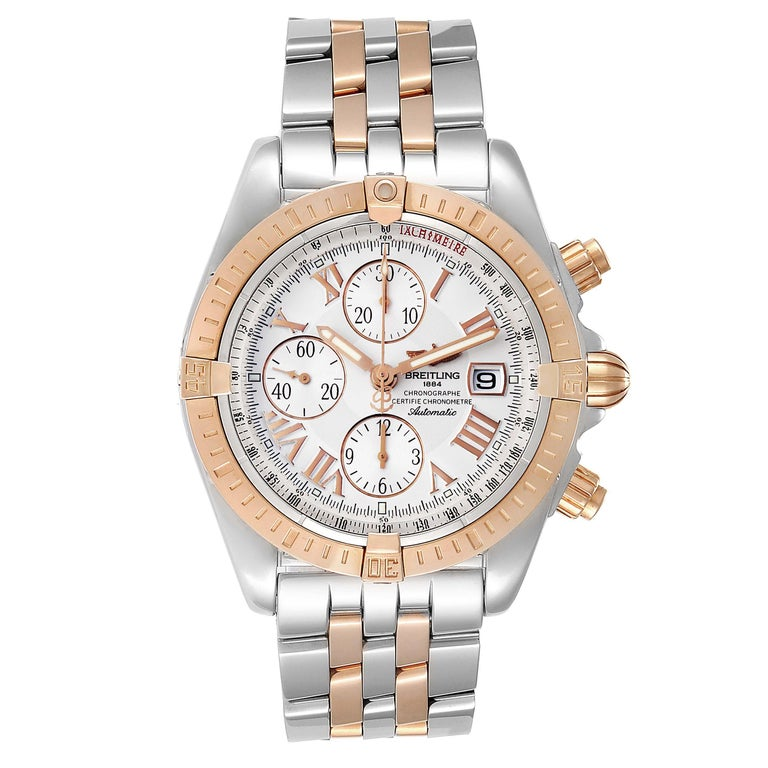Breitling Chronomat Evolution Steel Rose Gold Mens Watch C13356 Box Papers. Automatic self-winding officially certified chronometer movement. Chronograph function. Stainless steel and 18K rose gold case 43.7 mm in diameter. 18k rose gold