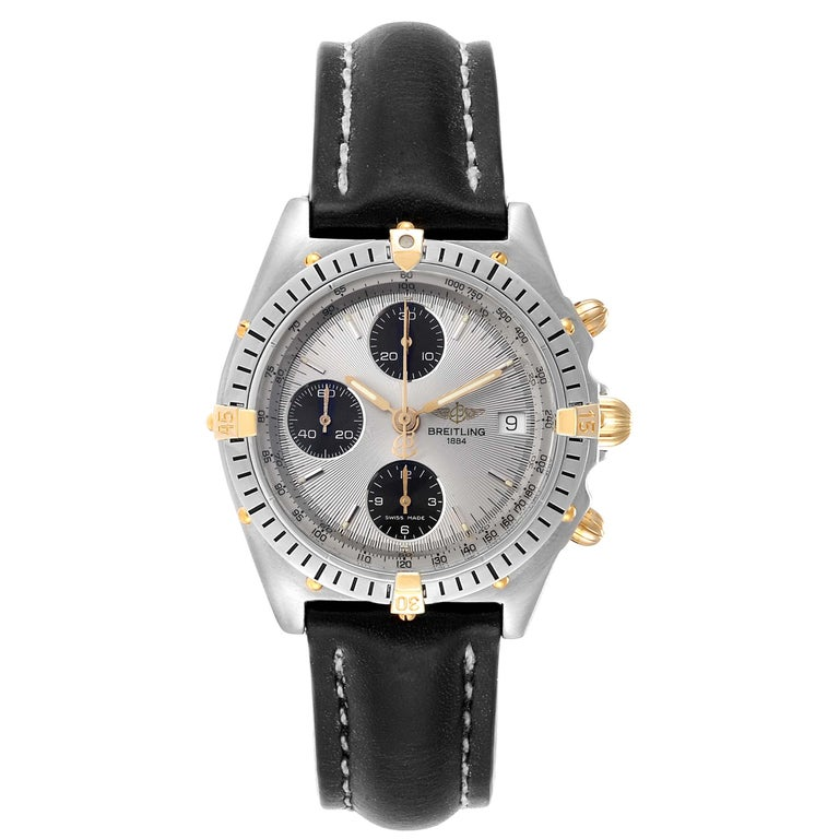 Breitling Chronomat Silver Dial Steel Yellow Gold Mens Watch B13050. Automatic self-winding officially certified chronometer movement. Chronograph function. Stainless steel case 39.0 mm in diameter. 18k yellow gold screwed-down crown and pushers.