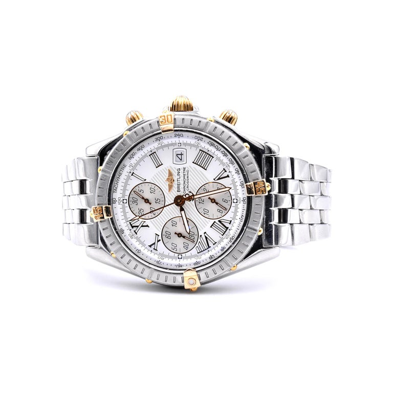 Designer: Breitling Movement: automatic Function: hours, minutes, small seconds, chronograph, date Case: round 43mm stainless steel case, scratch resistant sapphire crystal, water resistant to 300m, gold bezel indicators, gold push/pull crown Dial: