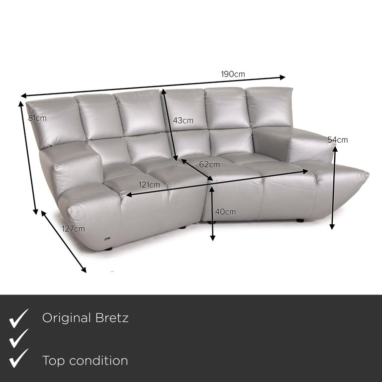 We present to you a Bretz Cloud 7 leather sofa silver.    Product measurements in centimeters:    Depth: 127 Width: 190 Height: 81 Seat height: 40 Rest height: 54 Seat depth: 62 Seat width: 121 Back height: 43.