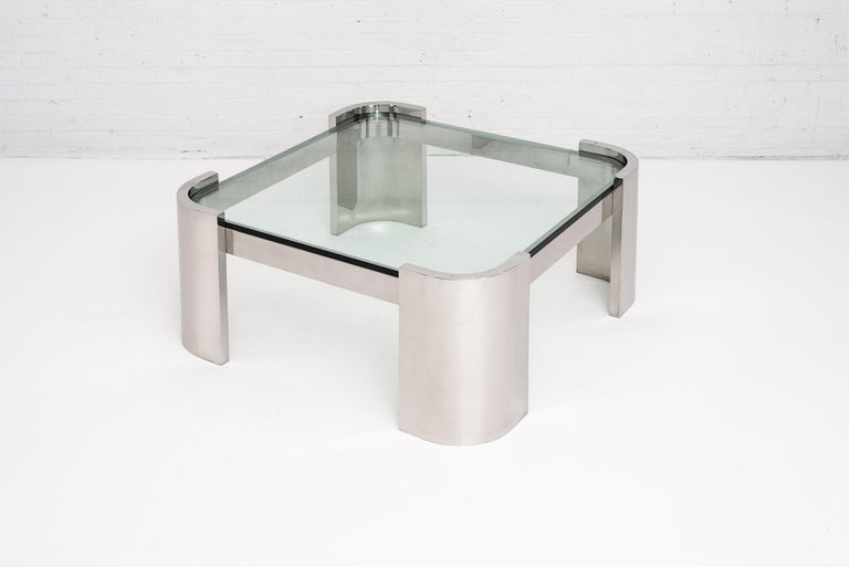 """Breuton polished stainless steel and glass top coffee table, circa 1970. Stainless steel with 3/4"""" glass top. Heavy stainless steel construction that Breuton is known for. Polished chrome finish."""