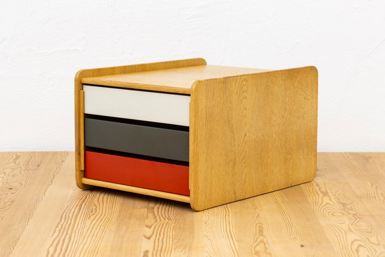 Desk organizer designed by Børge Mogensen. Produced in Sweden by Karl Andersson & Söner during the 1950s. Made from solid light oak with insert boxes in red, white and grey/green painted wood. Very good vintage condition with some age related wear