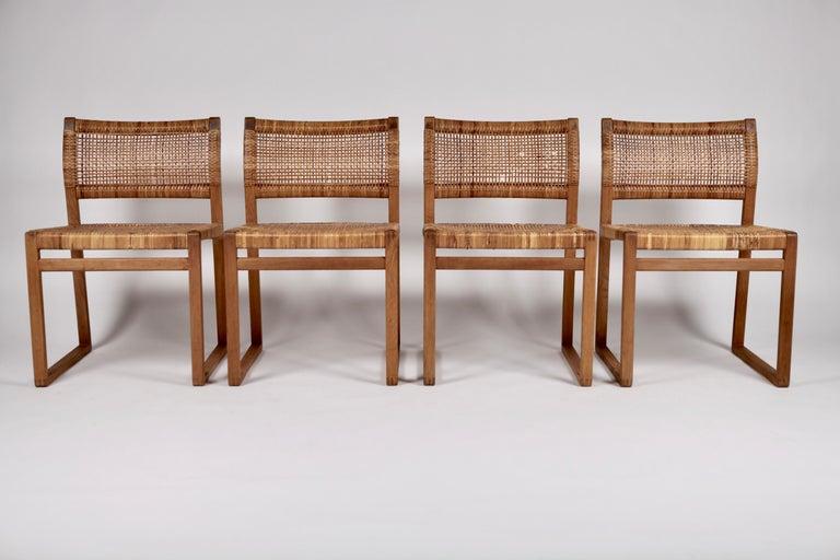Scandinavian Modern Børge Mogensen, Dining Chairs in Oak and Woven Cane, Denmark, 1957 For Sale