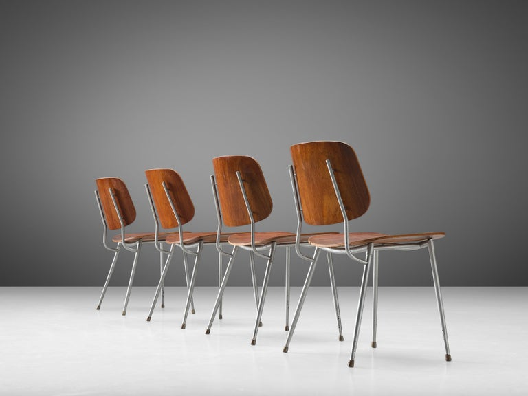 Børge Mogensen for Søborg Møbelfabrik, set of four dining chairs model 201, teak, steel, Denmark, 1953   This set of four dining chairs features a slender steel frame with molded teak seat and back. The chair consists of two wide and slightly curved