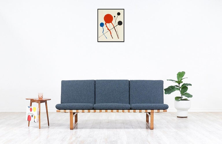 Early vintage Model 211 sofa designed by brilliant Danish architect Børge Mogensen in collaboration with the workshop of Fredericia Stolefabrik in Denmark during the 1950s. Mogensen's philosophy for this line was servicing functionalism and comfort