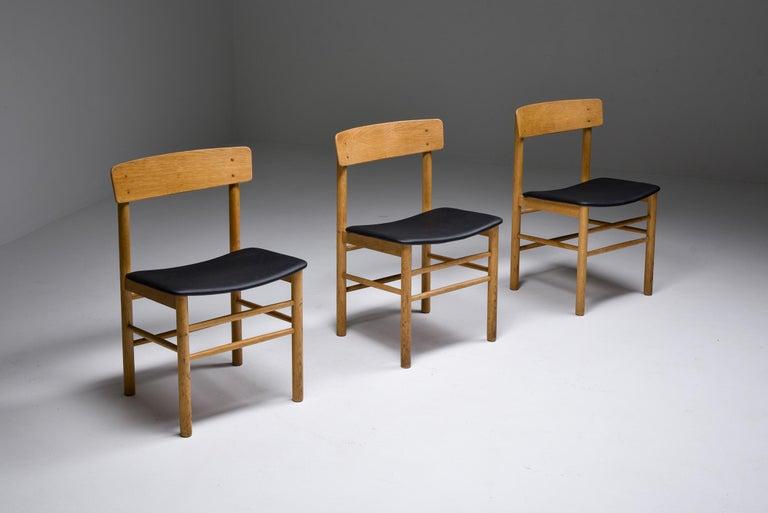 Scandinavian modern, Børge Mogensen, Fredericia Stølefabrik, Denmark, 1956.  Danish modern dining chairs in soap treated oak with seats in leather. This model 3236 chair was designed by Børge Mogensen in 1956 for Fredericia Stølefabrik. The chairs