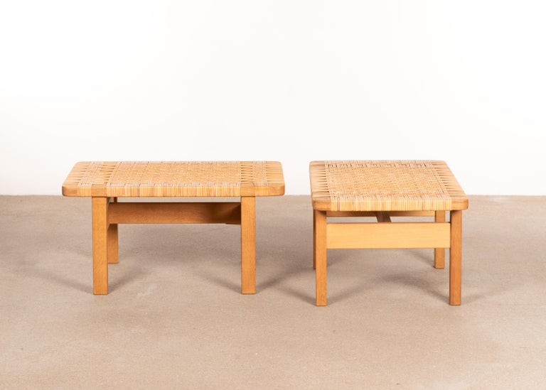 Elegant pair of benches or coffee tables (Model 5273) designed by Børge Mogensen for Fredericia Stølefabrik, Denmark. Solid soaped oak frames with cane all in very good original condition and signed by manufacturer. Very minor staining,