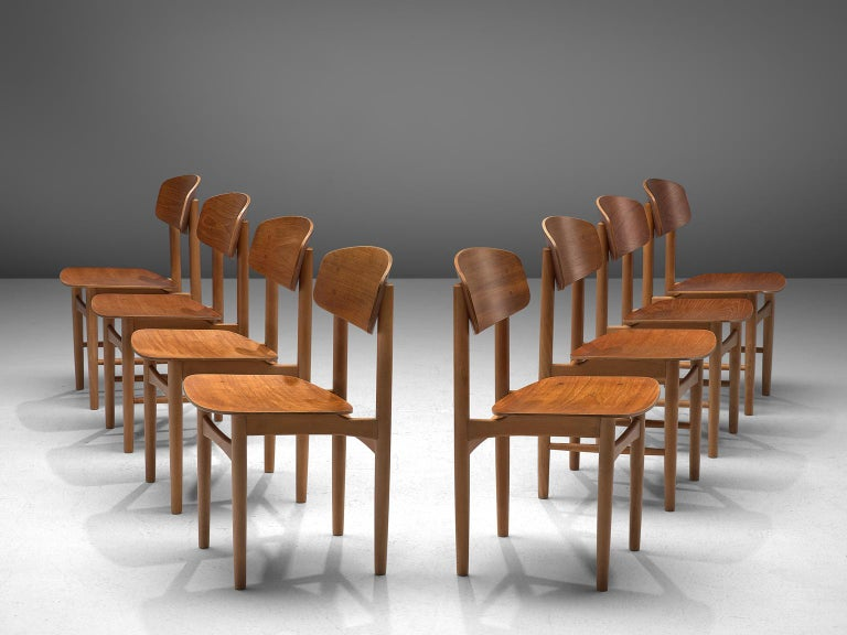 Børge Mogensen for Soborg, set of 8 chairs model 122, teak, Denmark, circa 1950.   This set of chairs is derived from the shell chair that Mogensen designed in 1949 for the cabinetmakers guild. The shell chair distinguishes itself by the use of a