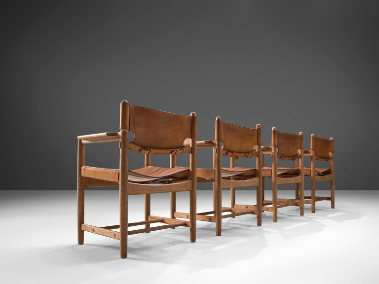 Børge Mogensen for Fredericia Stolefabrik, set of 4 chairs model 3238, in oak and leather, Denmark, 1964.   Set of four armchairs in solid oak. These chairs remind of the classical foldable 'director-chairs', yet this design by Danish designer