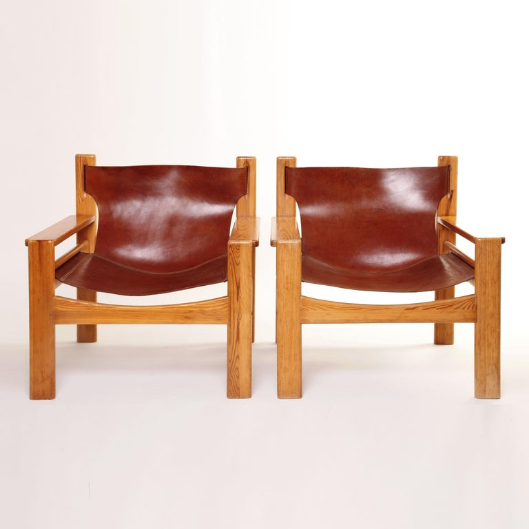 A unique pair of Børge Mogensen lounge armchairs. Sling Spanish style tan saddle leather on blond oak. Some wear, occasional scratches, fading or discoloration. for international shipping quotes please ask.