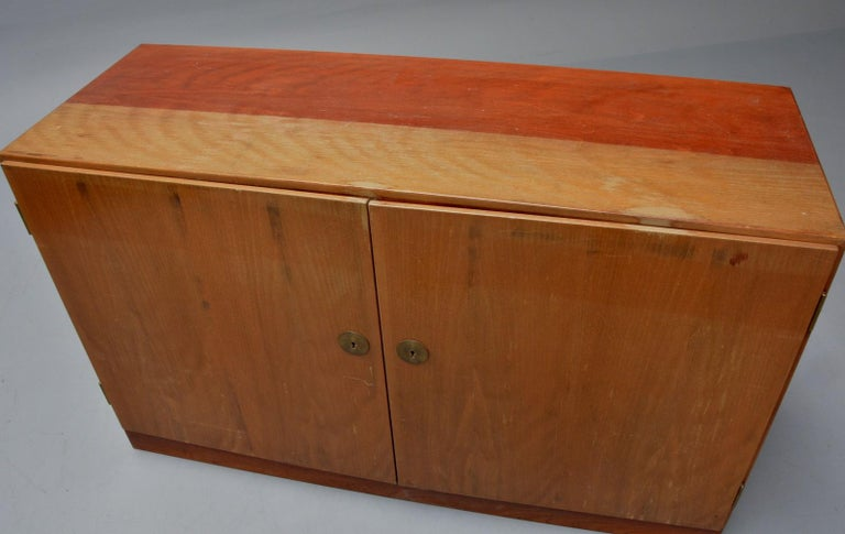 Rare Børge Mogensen model A 232 cabinet produced by C. M. Madsen for FDB, Denmark 1950's. This cabinet is made out of teak and has two doors revealing an interior with shelves and pull-out trays made out of maple wood. Unfortunatelly missing keys.