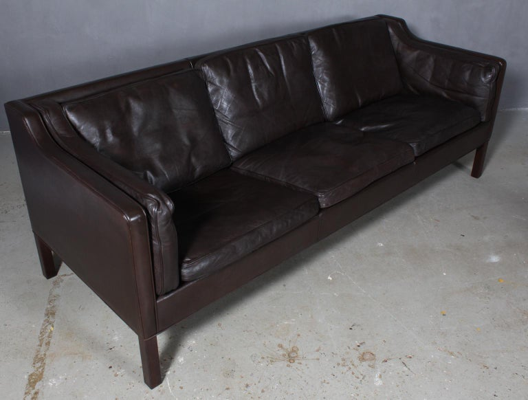 Børge Mogensen three-seat sofa with original brown leather upholstery.  Legs of mahogany.  Model 2213, made by Fredericia Furniture.
