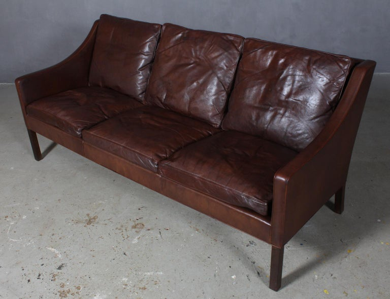 Børge Mogensen three-seat sofa original upholstered in brown leather.  Legs of stained oak.  Model 2209, made by Fredericia Furniture.